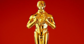 Woody Allen wins Best Original Screenplay and The Descandants wins Best Adapted Screenplay at the Oscars 2012
