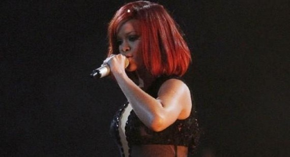 What is the writing style of Rihanna's rib and collar bone tattoo?