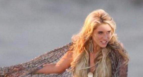 Is Kesha making fun of Taylor Swift by saying 'I'm not a heel wearing princess'