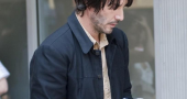 Keanu Reeves Walking Around Set Of Um Bill