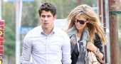 Nick Jonas Delta Goodrem Hand Hold Hair
