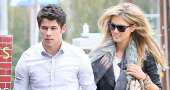 Nick Jonas Delta Goodrem Holding Hands Hair