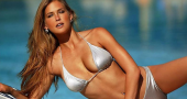 Bar Refaeli steams up Superbowl ad with a kiss, also starring Danica Patrick
