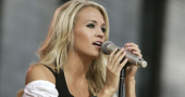 Carrie Underwood says Simon Cowell hates Country music