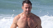 Hugh Jackman practises his singing in the shower