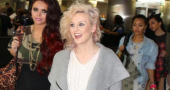 Perrie Edwards shows of new neck piercing