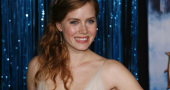 Amy Adams wins the best actress award at the Golden Globes 2014