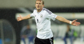 Andre Schurrle says Wayne Rooney is not the right fit for the German team