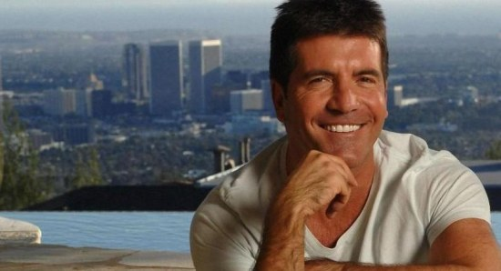 Simon Cowell flashes a smile