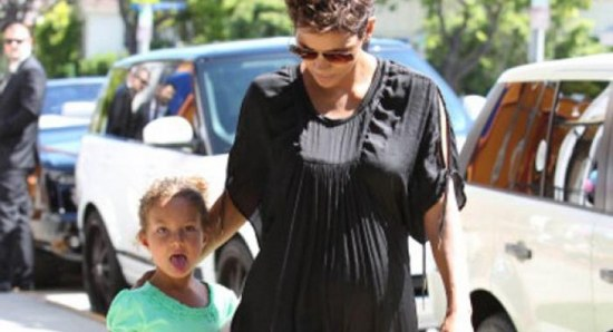 Halle Berry shows off baby bump in revealing dress