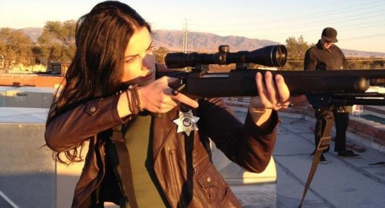 Jaimie Alexander shooting a rifle