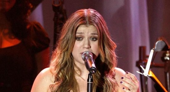 Kelly Clarkson performing at a concert
