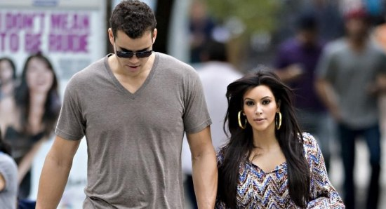 Kim is still legally married to Kris humphries