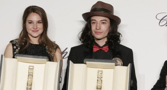 Shailene Woodley with Ezra Miller accepting their Best Newcomer prizes from Chopard