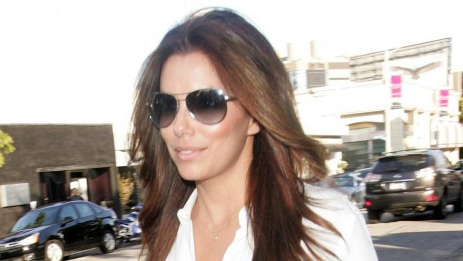 Eva Longoria excites fans in white shorts & neon top at b-day party