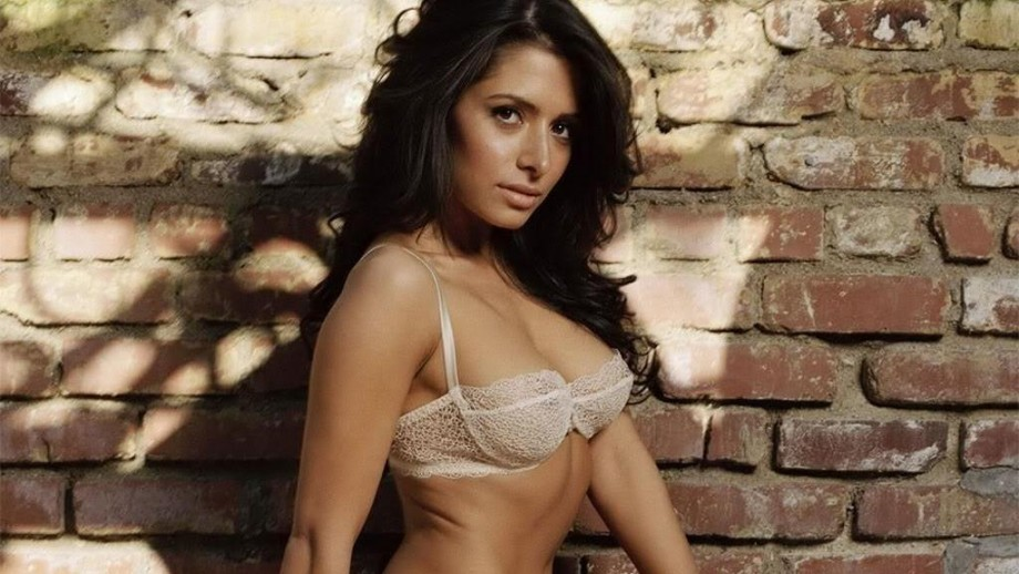 Sarah Shahi says being a cheerleader was good practice for Hollywood