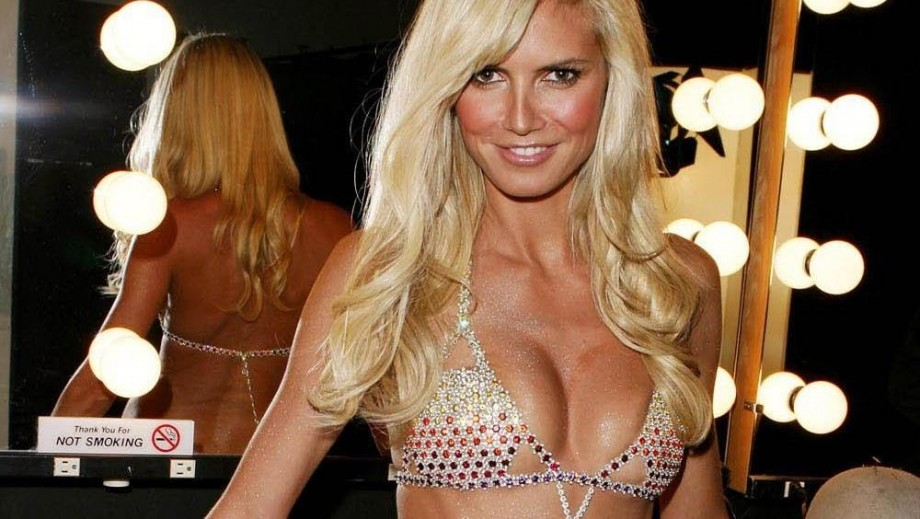 Heidi Klum gets fans excited in pink jumper   lingerie from Intimates line 285189e7b